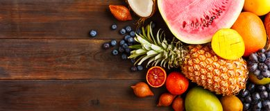 Ripe fruit on a wooden background stock photography