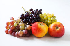 Ripe fruits. Apples and grapes on a white background Royalty Free Stock Image