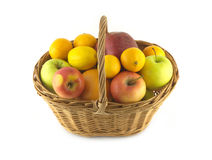 Ripe fruits and apples in wicker basket isolated Royalty Free Stock Photography