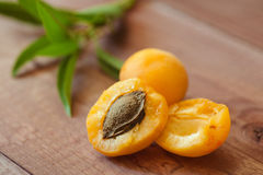 Ripe fruits of apricots on a wooden table Royalty Free Stock Photo