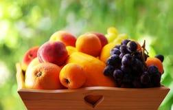 Ripe fruits on  basket Stock Photo