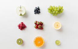 Ripe fruits and berries on white surface Royalty Free Stock Image