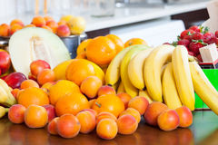 Ripe fruits on kitchen table Stock Photography