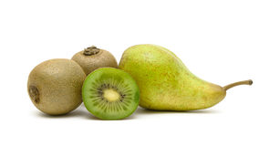 Ripe fruits: kiwi and pear isolated on white background Stock Images