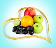 Ripe fruits and measuring ribbon isolated. Ribbon ripe measuring fruits green color red royalty free stock photography
