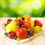 Ripe fruits on a plate Stock Photos