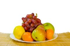 Ripe fruits in plate on table Royalty Free Stock Image