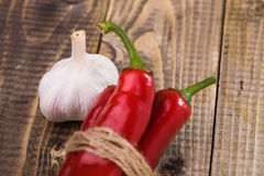Ripe garlic and der peppers spiciness Stock Image