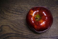 Ripe and glossy apple and wood Stock Photography