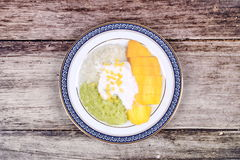 Ripe golden mango with green and white of sticky rice. Royalty Free Stock Photography