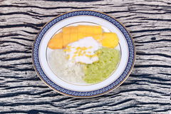 Ripe golden mango with green and white of sticky rice. Royalty Free Stock Image