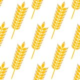 Ripe golden wheat in a seamless pattern. Ears of ripe golden wheat in a seamless background pattern with a repeat vector motif in square format for agriculture Royalty Free Stock Images