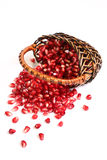 Ripe grains of a pomegranate in a basketon. Royalty Free Stock Image