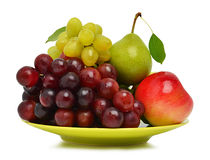 Ripe grape, the apple and pear on the plate Stock Photo