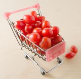 Ripe Grape Tomatoes in A Shopping Cart Stock Photos