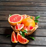 Ripe grapefruit in the basket stock photos