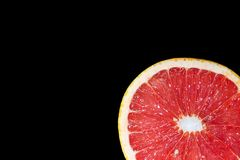 Ripe grapefruit on a black isolated background royalty free stock photography