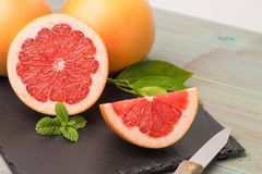 Ripe grapefruit. Close-up on wooden table background stock photos