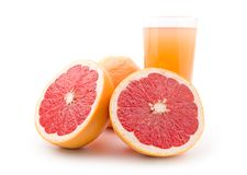 Ripe grapefruit and a glass of juice Royalty Free Stock Images