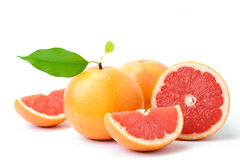 Ripe grapefruit with leaves and slices Stock Images