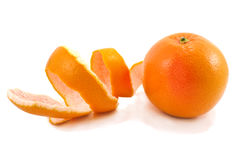 Ripe grapefruit and long peel. Stock Images