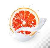 The ripe grapefruit in a milk splash on a transparent background Stock Photo