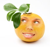 Ripe grapefruit with a person smiling girl Royalty Free Stock Photography