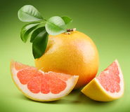 Ripe grapefruit with segmentы Royalty Free Stock Image