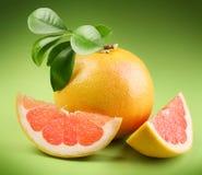 Ripe grapefruit with segmentы Royalty Free Stock Image