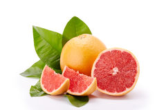 Ripe grapefruit on a white background. Stock Photos