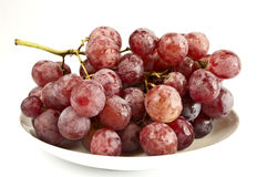 Ripe grapes. On a white plate Stock Images