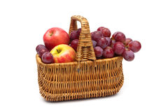 Ripe grapes and apples in the basket on a white background Stock Image