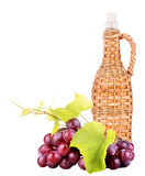 Ripe grapes and bottle of wine Royalty Free Stock Photos