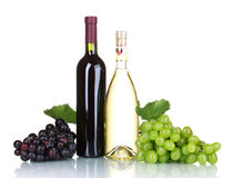 Ripe grapes and bottles of wine Royalty Free Stock Photos