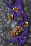 Ripe grapes and figs on dark wooden table Stock Image