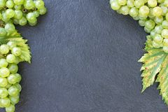 Ripe grapes on a dark stone stock photo