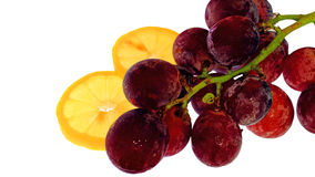 Ripe grapes with a lemon slice Stock Image