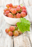 Ripe grapes in a white bowl with a leaf Stock Photography