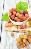Ripe grapes in white bowl Royalty Free Stock Images