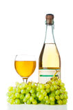 Ripe grapes, wine glass and bottle Stock Images