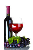 Ripe grapes, wine glass and bottle of wine Stock Photo