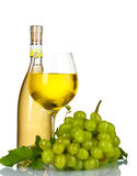 Ripe grapes, wine glass and bottle of wine Stock Image