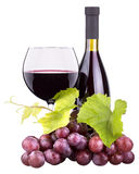 Ripe grapes, wine glass and bottle of wine Stock Images