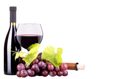 Ripe grapes, wine glass and bottle of wine Stock Photography