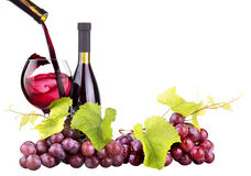 Ripe grapes, wine glass and bottle of wine Royalty Free Stock Photos