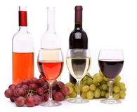 Ripe grapes, wine glasses and bottles of wine. Isolated on a white background Royalty Free Stock Photography