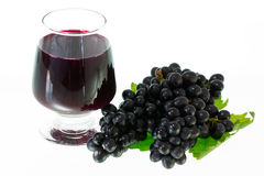Ripe grapes and wine isolate Stock Photos