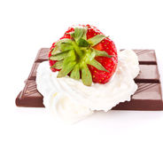Ripe great strawberriy with cream and chocolate bar on white bac Stock Image