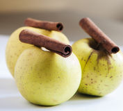 Ripe green apple with cinnamon sticks Stock Photo