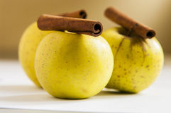 Ripe green apple with cinnamon sticks Royalty Free Stock Photography